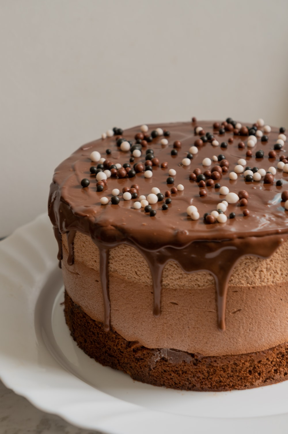chocolate cake with white icing on white ceramic plate