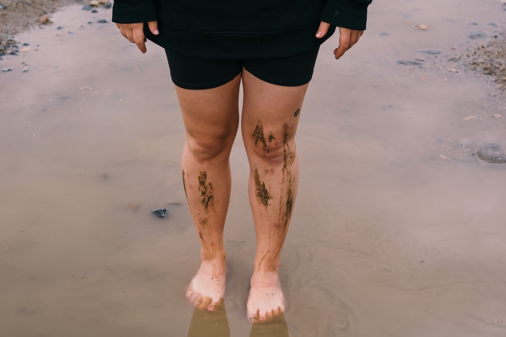 person in black shorts with skin tattoo