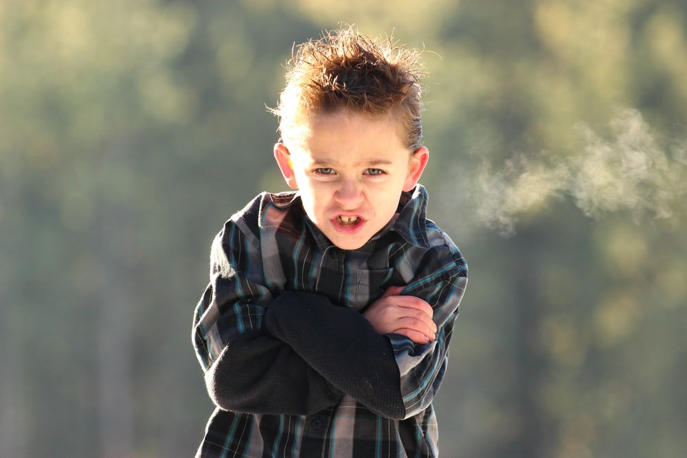 boy in black and white plaid coat