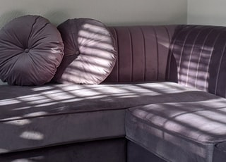 pink and white striped sofa