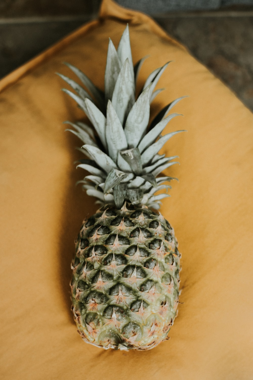pineapple fruit on brown textile