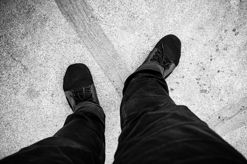 person in black pants and black shoes