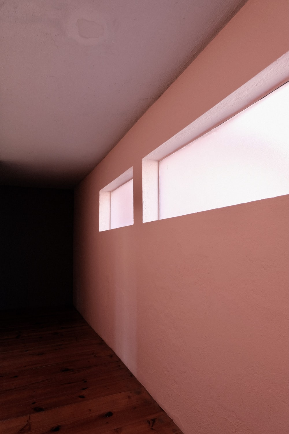 brown wooden floor and white wall