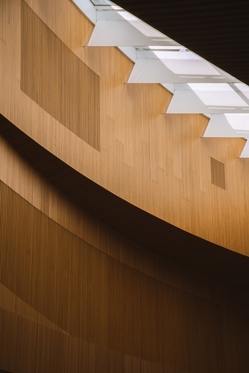 brown wooden wall with white wooden arrow