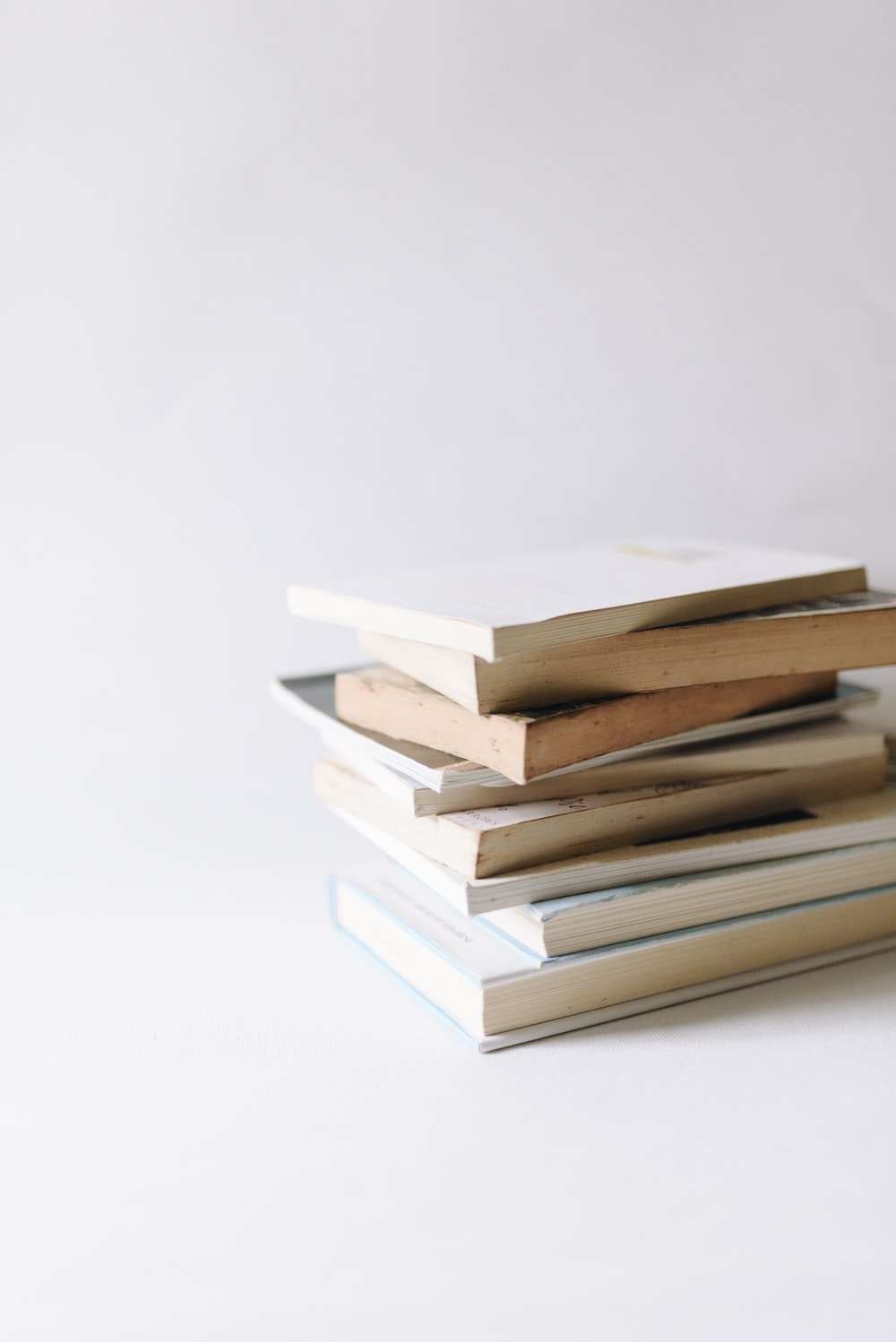 stack of books on white surface