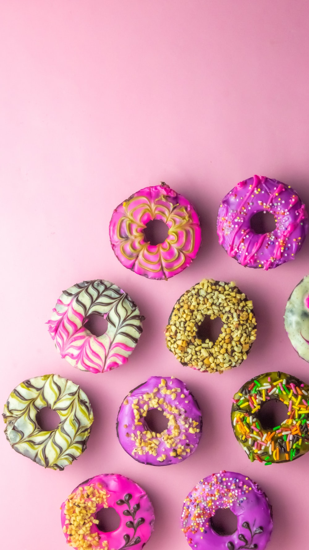 pink and green doughnut on white surface