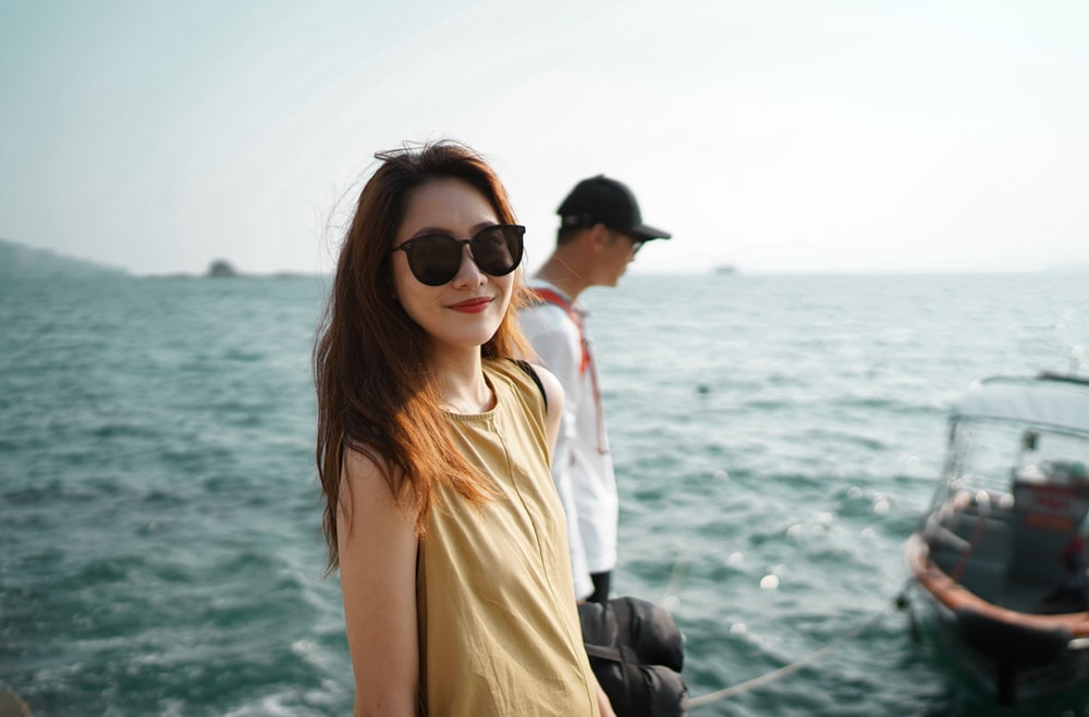woman in white tank top and black sunglasses