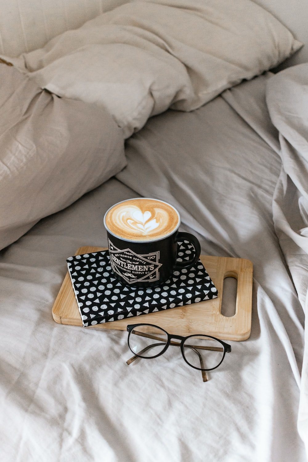 black and white ceramic mug on brown wooden tray