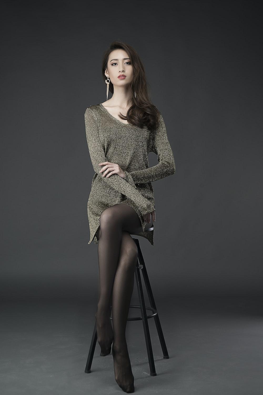 woman in brown long sleeve dress sitting on black chair