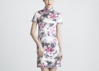 woman in white and pink floral dress