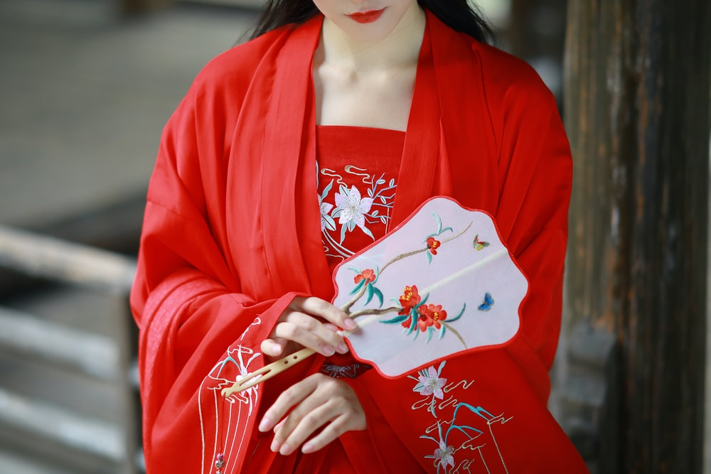 woman in red and white kimono