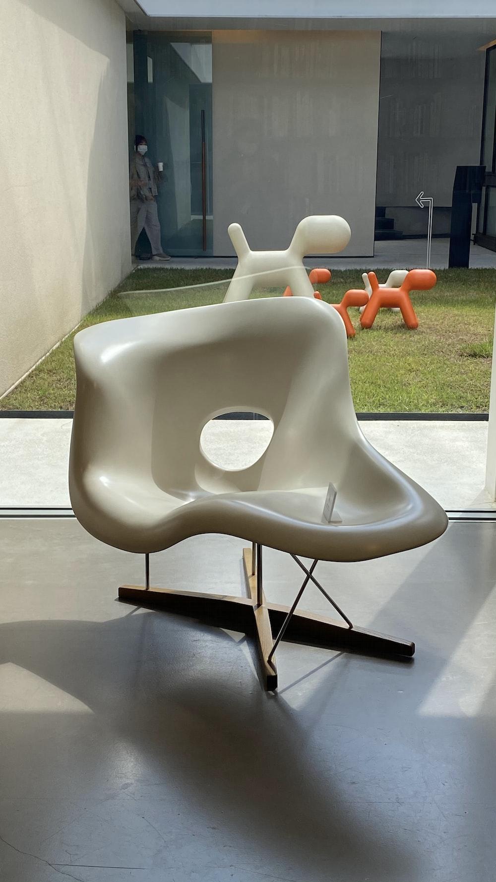 white plastic armchair on gray concrete floor