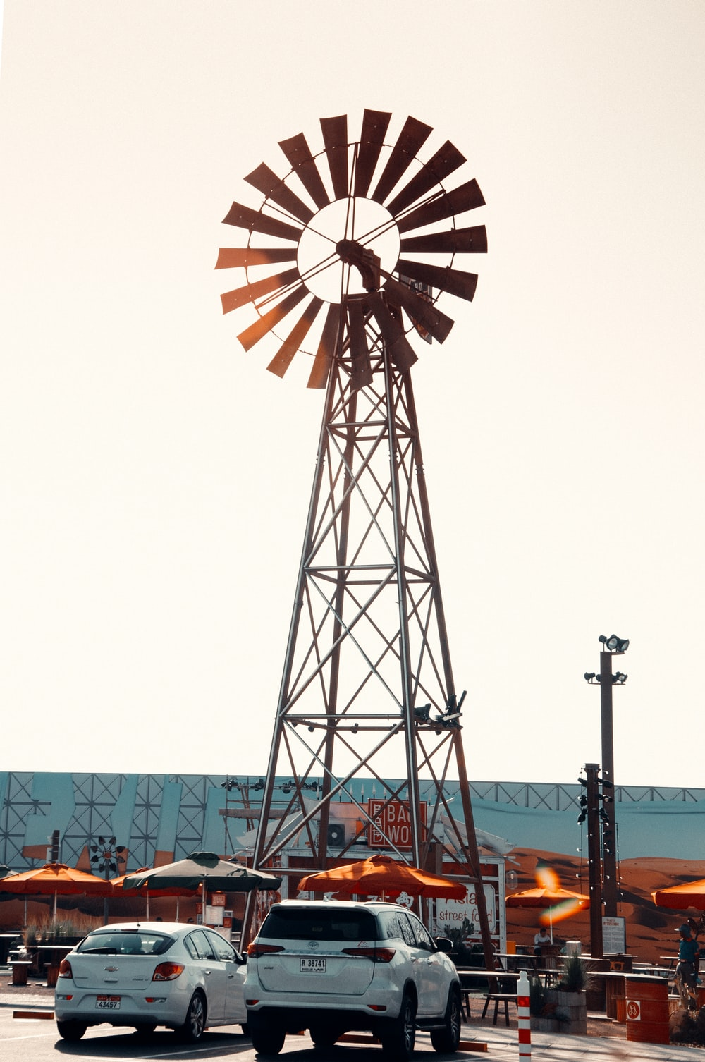 orange and white ferris wheel under white sky during daytime