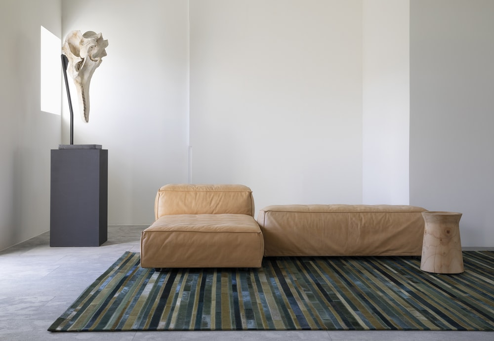 beige sofa near white wall