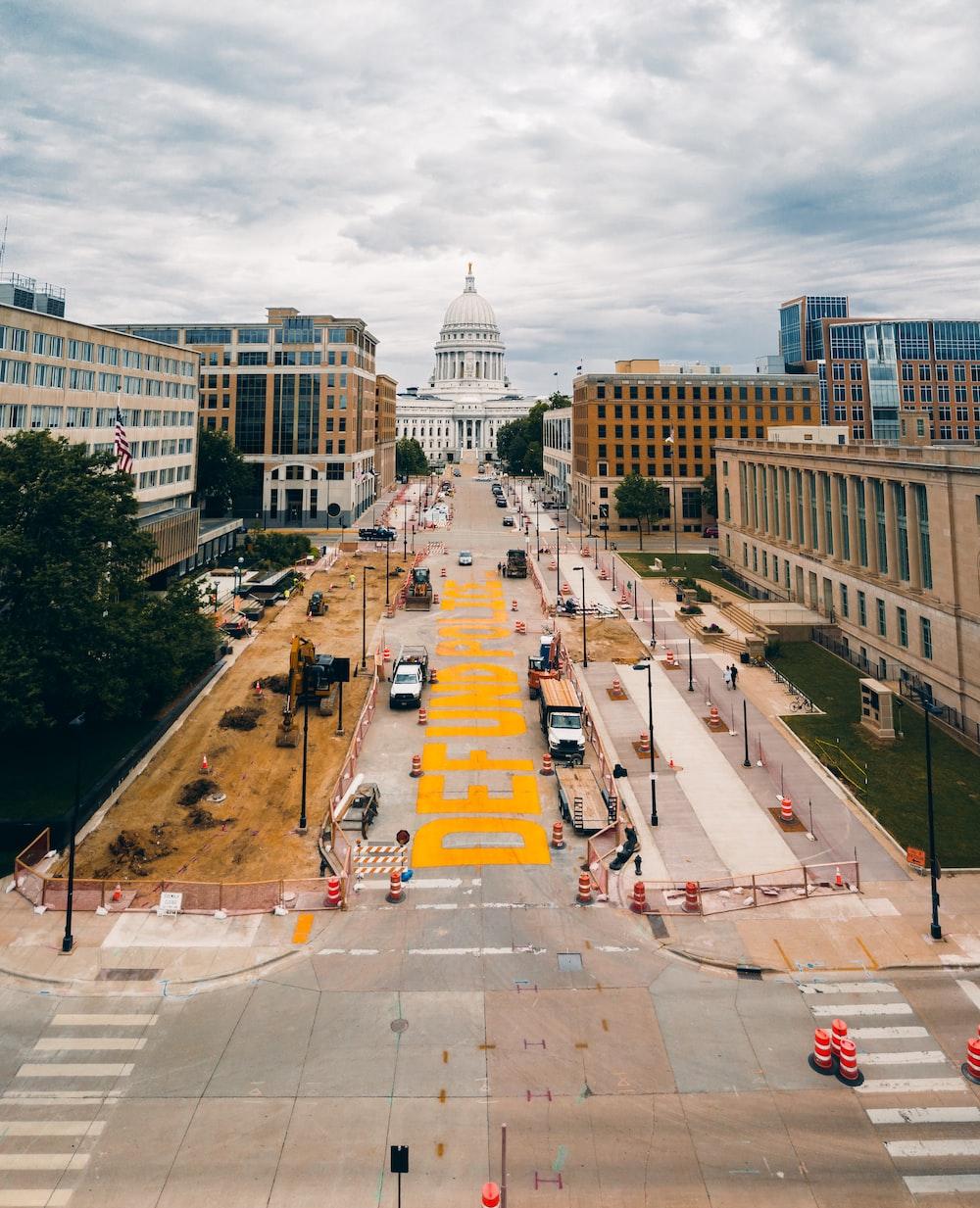 people walking on pedestrian lane near building during daytime