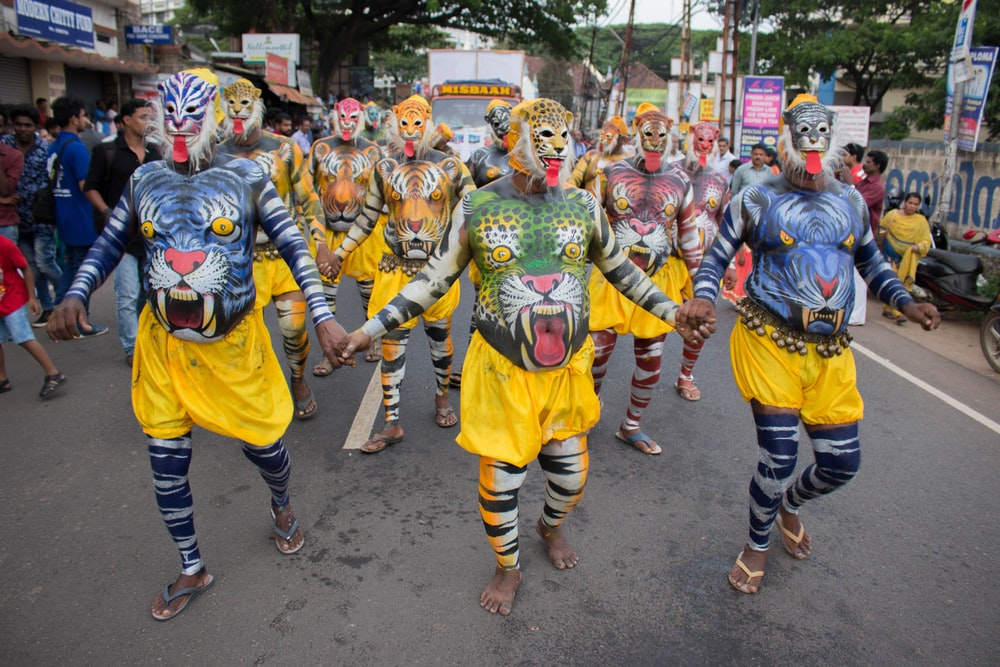 group of people wearing yellow and blue costume