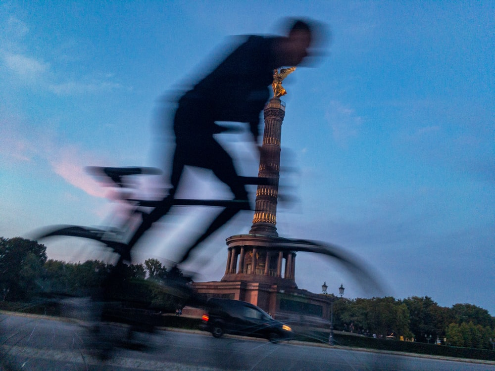 man in black jacket and black pants playing electric guitar near eiffel tower during daytime