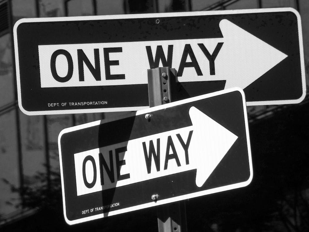 white and black pedestrian lane sign