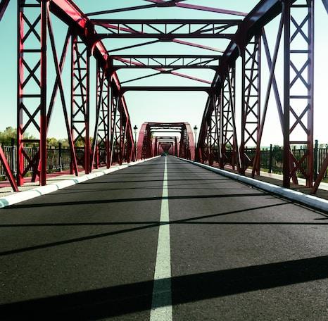 red metal bridge during daytime