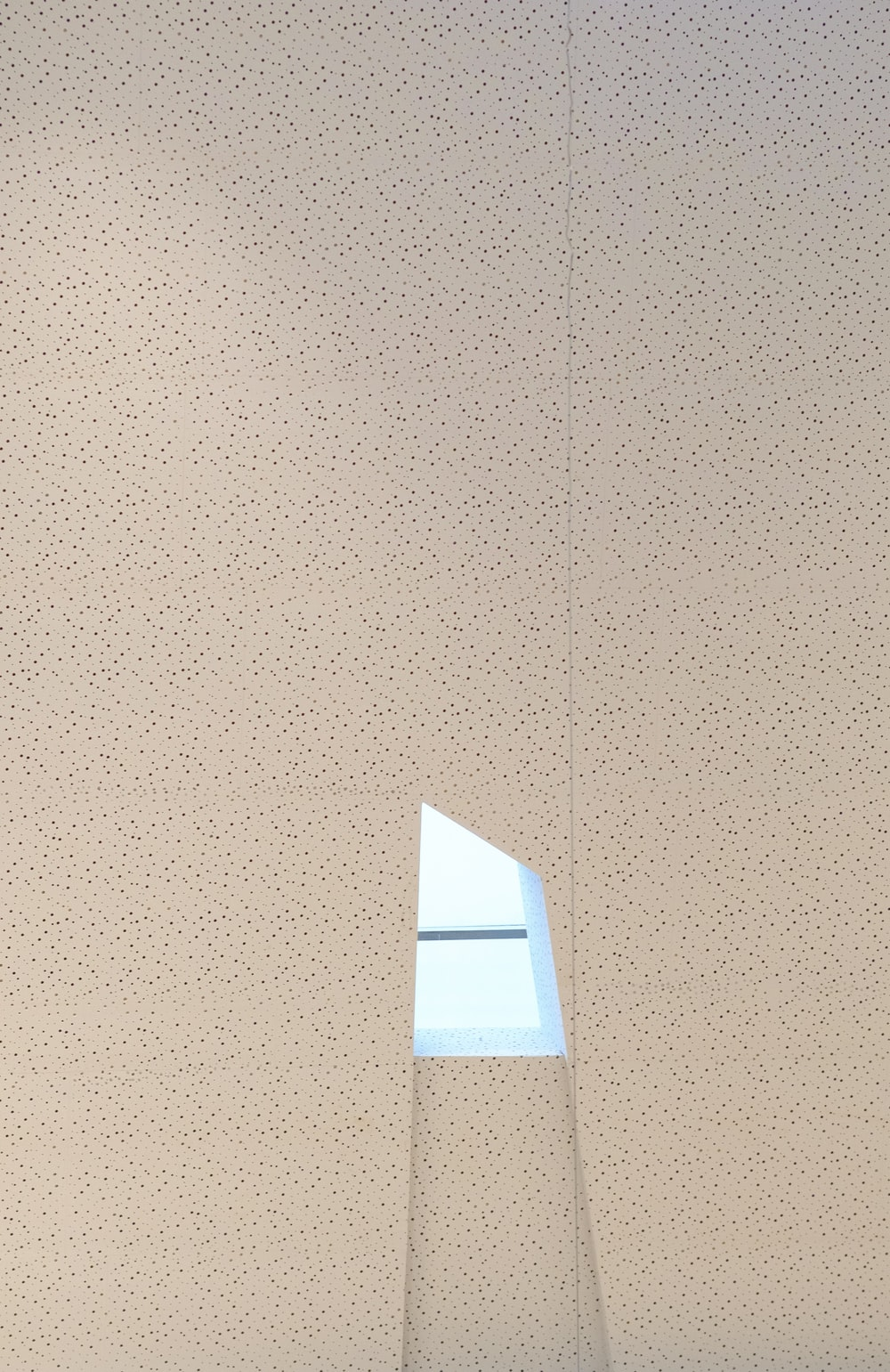 white paper on brown wall