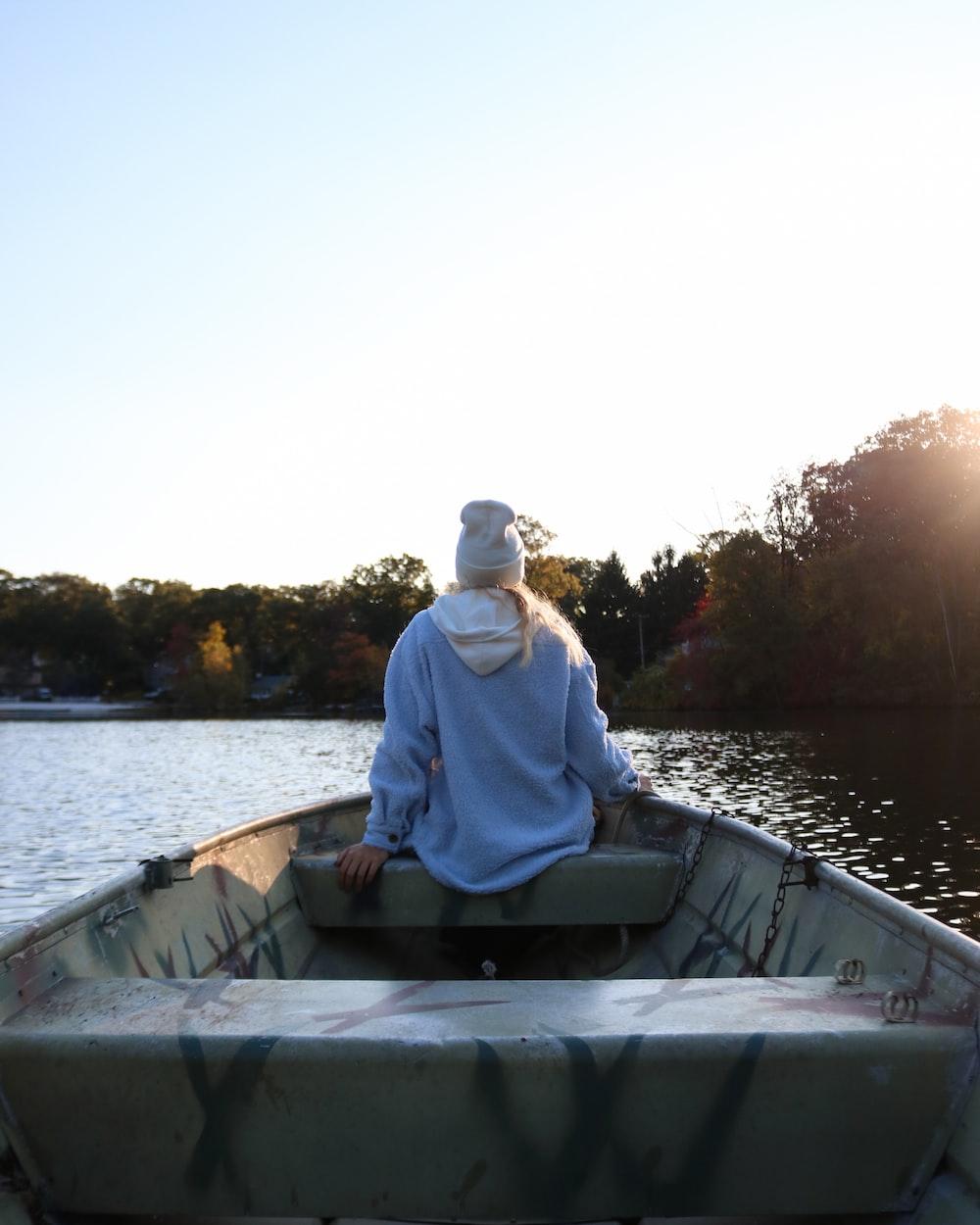 man in white dress shirt sitting on boat during daytime