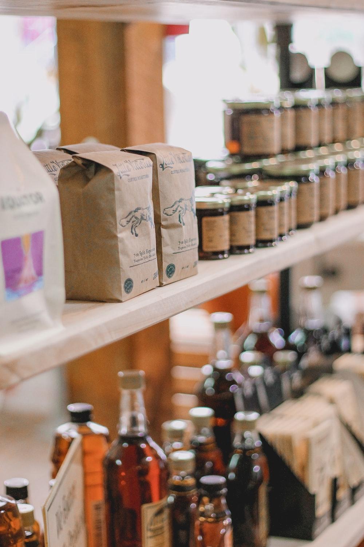 brown cardboard boxes on brown wooden shelf