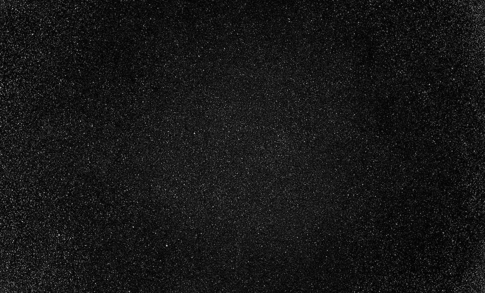 black textile on black background