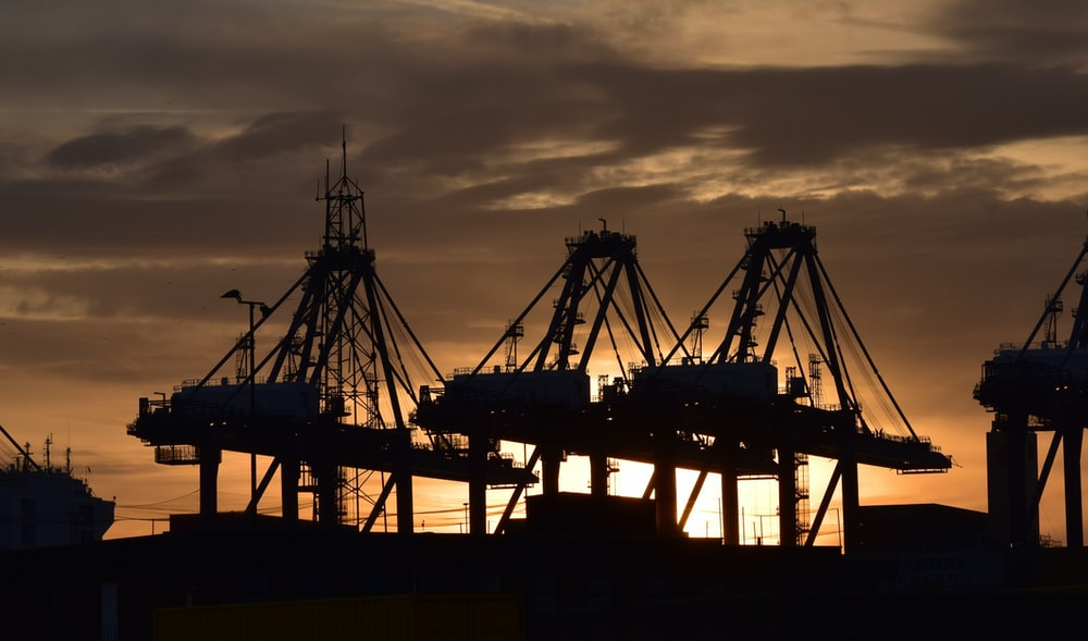 silhouette of cargo ship during sunset