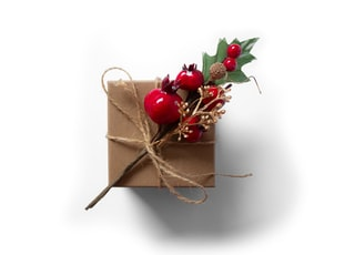 red cherries on brown gift box