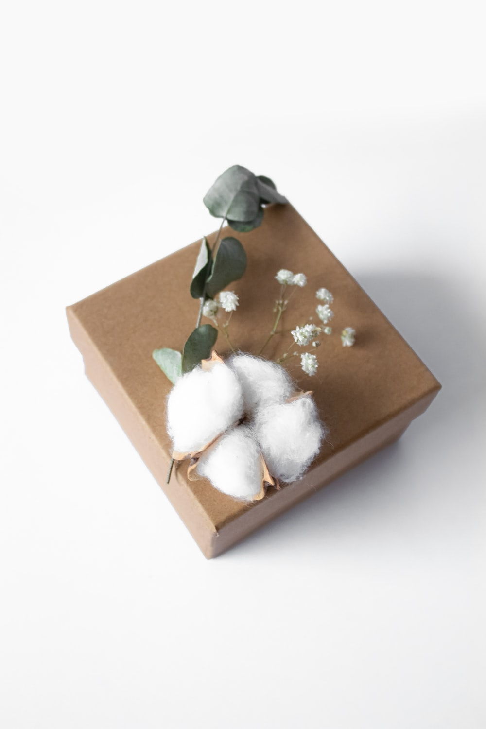 white and gray rabbit plush toy in brown cardboard box