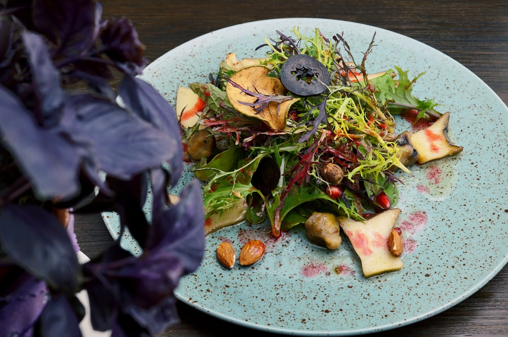 green and red vegetable salad on white ceramic plate