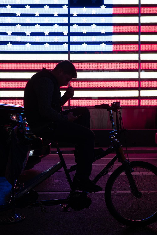 man in black long sleeve shirt sitting on black and gray wheel chair