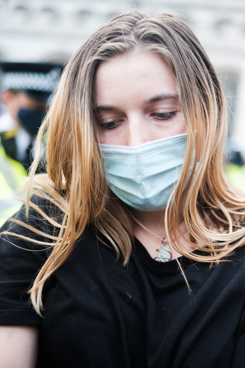 woman in black shirt with white face mask