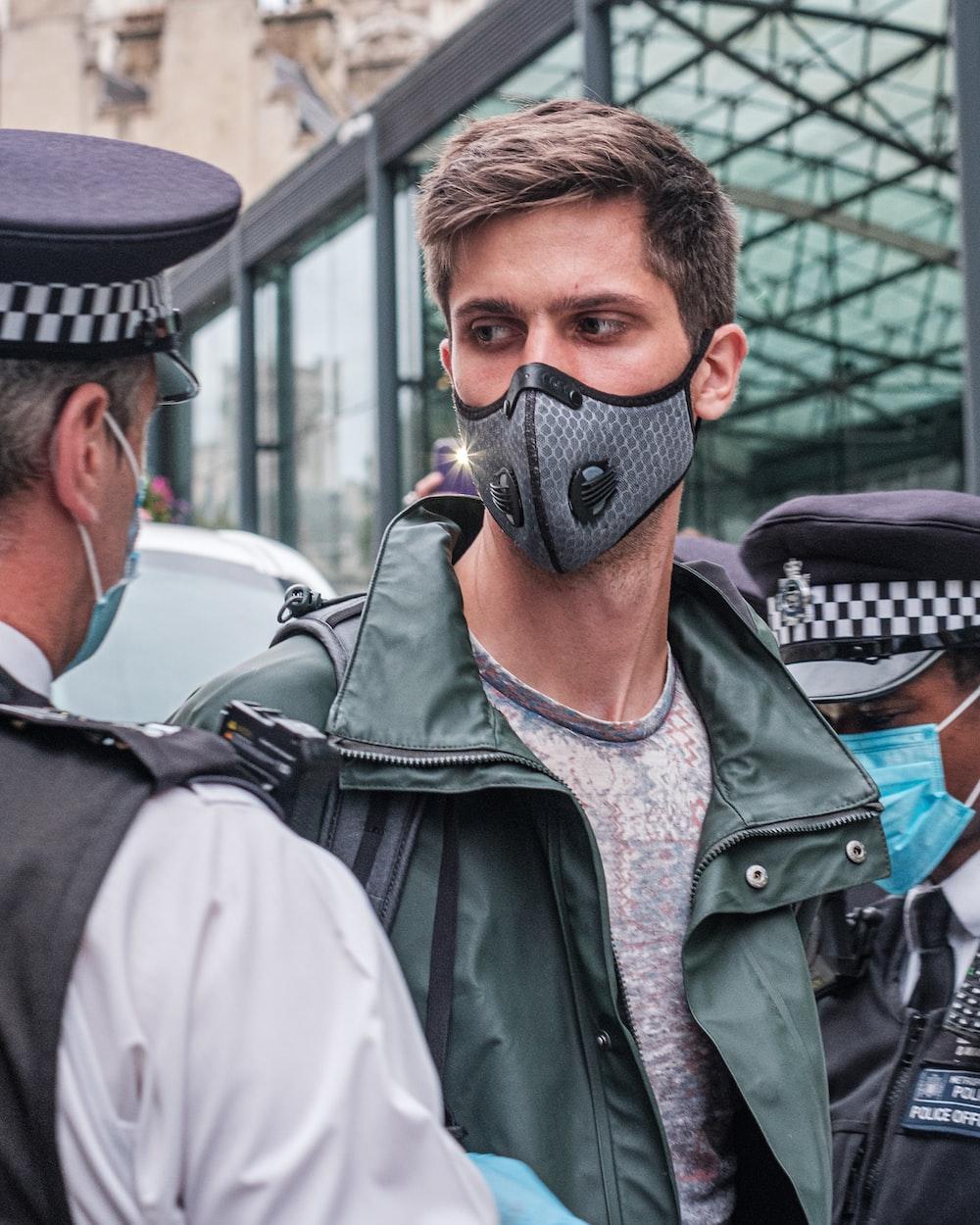 man in black leather jacket wearing black mask