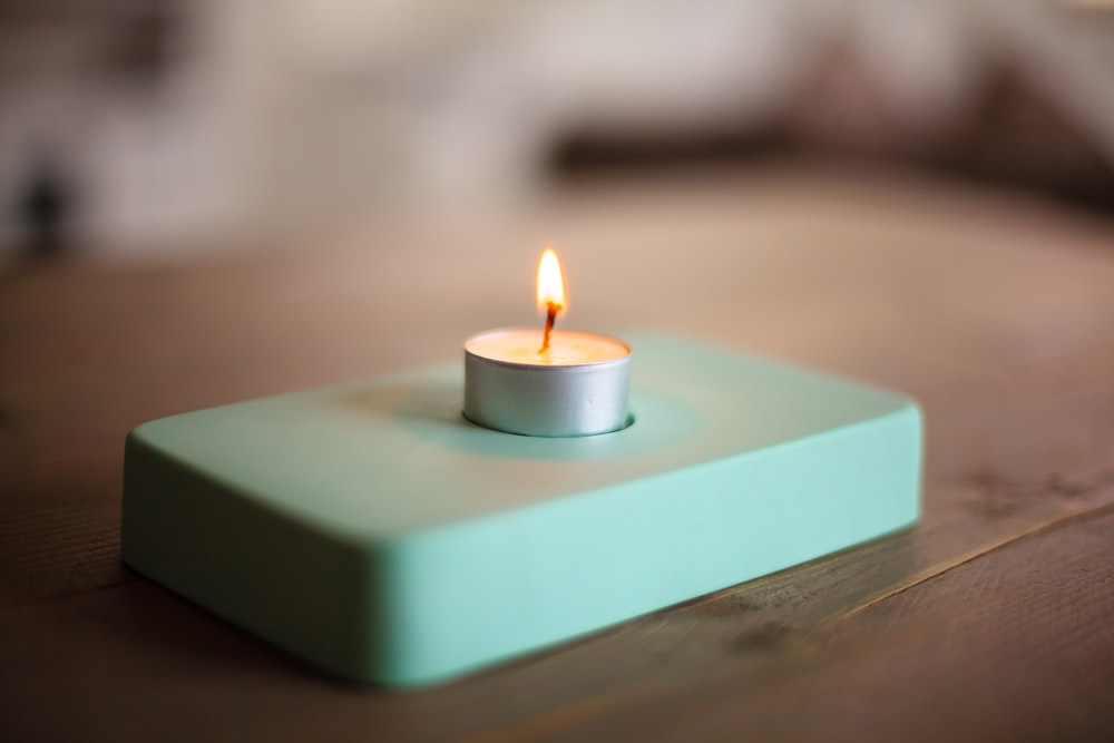 blue candle on blue table