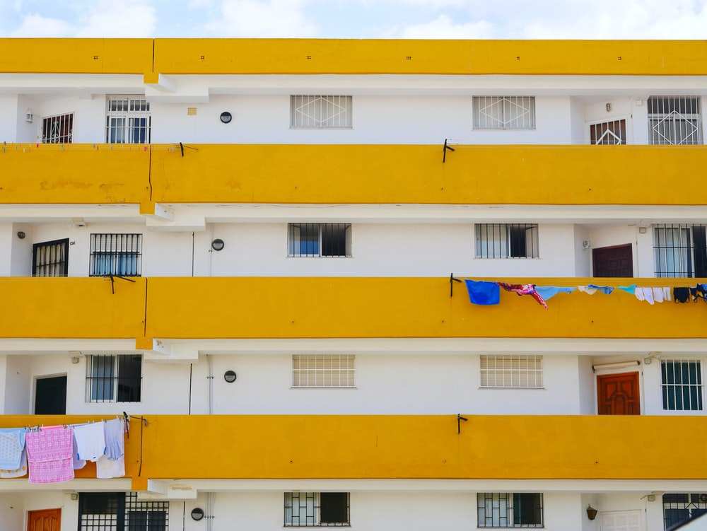 yellow blue and white concrete building
