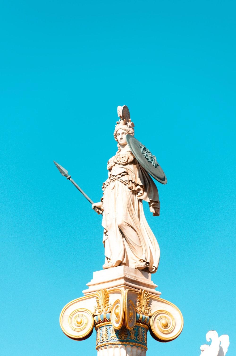 man holding a sword statue