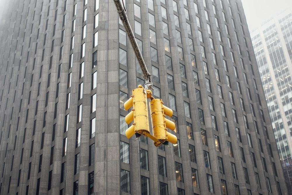 yellow pendant lamp on gray concrete building