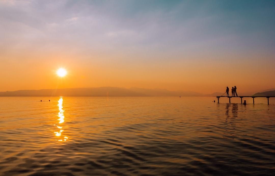 The sun setting on the horizon over Lake Ohrid