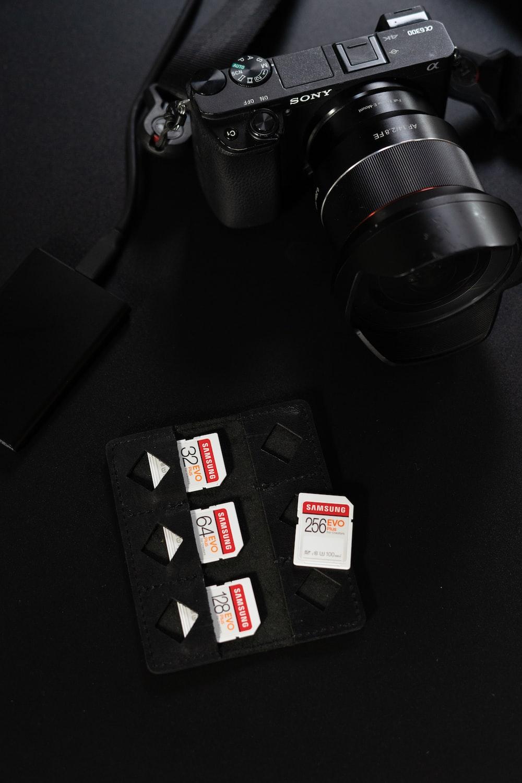 black nikon dslr camera on black table
