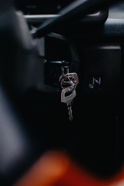 silver key on black car