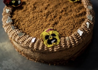 brown round cake with yellow and black butterfly on top