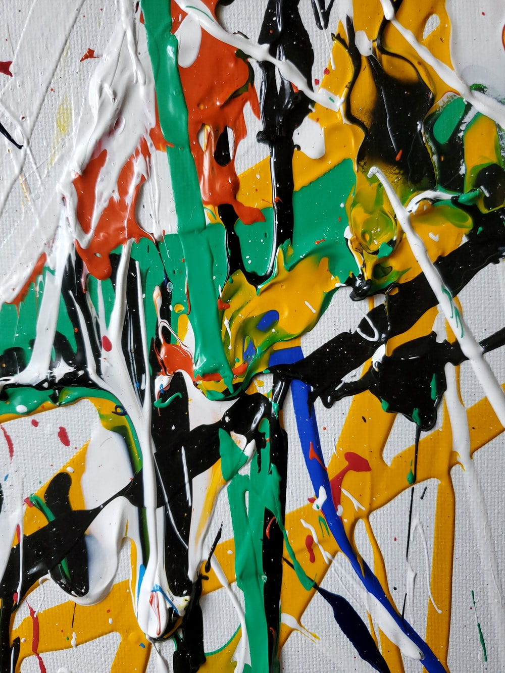 white green red and yellow abstract painting