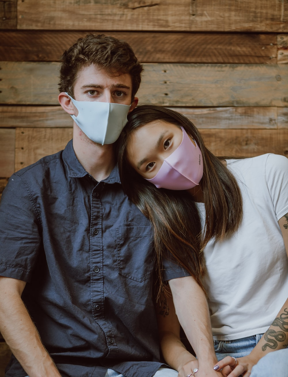 woman in white shirt and blue denim button up jacket with white face mask