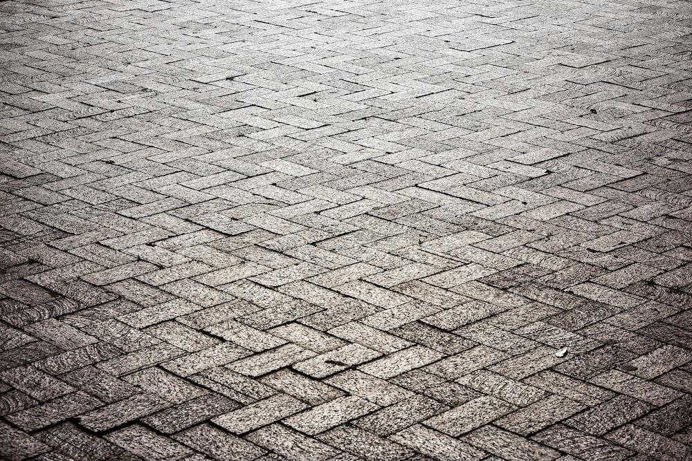 brown brick floor near body of water during daytime