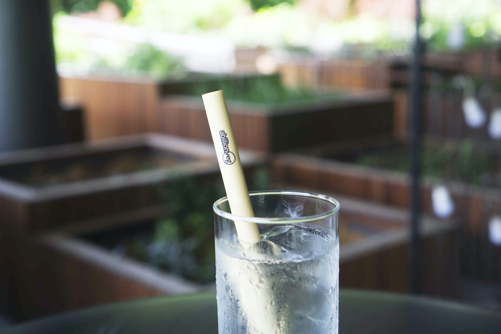clear drinking glass with white straw
