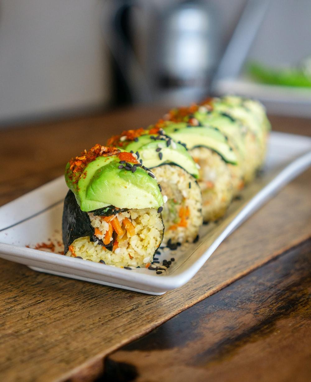 sushi on white ceramic rectangular plate