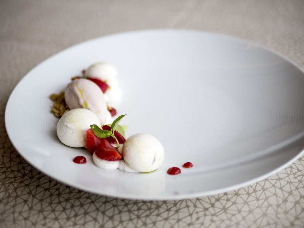 white ceramic plate with sliced fruits
