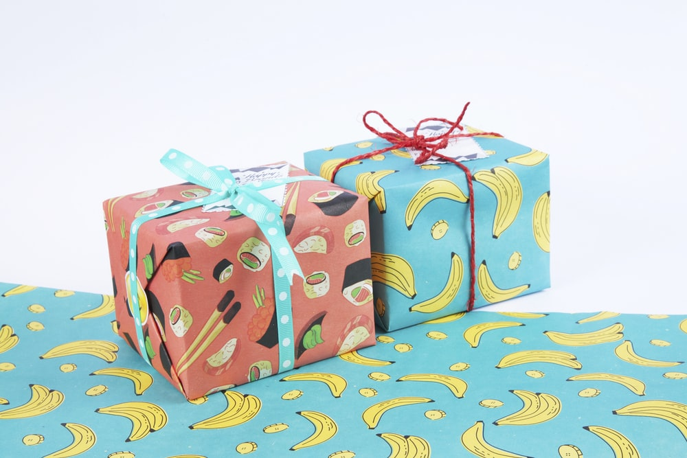 red and white floral gift boxes