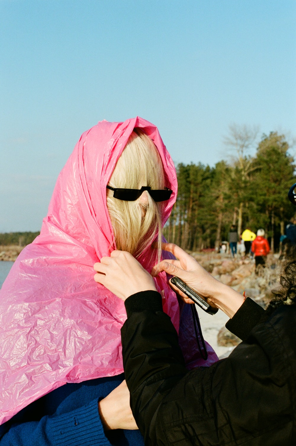 woman in pink hijab and black long sleeve shirt